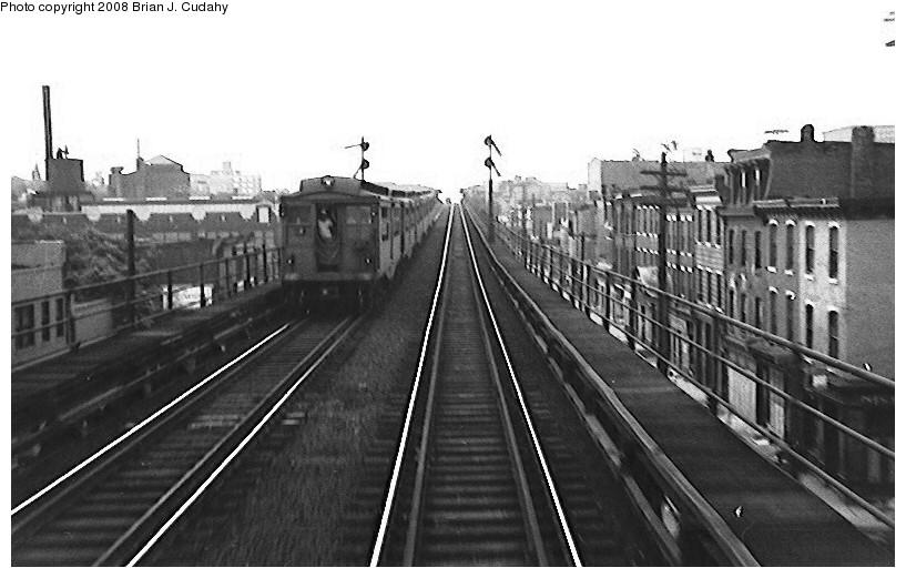 (132k, 817x521)<br><b>Country:</b> United States<br><b>City:</b> Philadelphia, PA<br><b>System:</b> SEPTA (or Predecessor)<br><b>Line:</b> Market-Frankford El<br><b>Car:</b> PTC/SEPTA M-1 (Pressed Steel/Brill, 1906-1913)   <br><b>Photo by:</b> Brian J. Cudahy<br><b>Date:</b> 4/24/1954<br><b>Notes:</b> Westbound train on since abandoned section of Market Street el; note semaphore signals.<br><b>Viewed (this week/total):</b> 2 / 2238