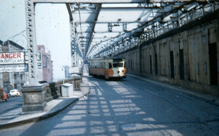 (105k, 742x462)<br><b>Country:</b> United States<br><b>City:</b> New York<br><b>System:</b> Queensborough Bridge Railway<br><b>Photo by:</b> Brian J. Cudahy<br><b>Date:</b> 5/4/1955<br><b>Notes:</b> QBRy car heading off the bridge into the underground Manhattan terminal.<br><b>Viewed (this week/total):</b> 0 / 1738
