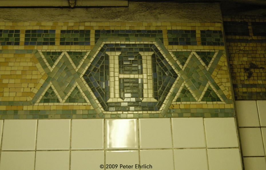 (190k, 930x596)<br><b>Country:</b> United States<br><b>City:</b> New York<br><b>System:</b> New York City Transit<br><b>Line:</b> IRT West Side Line<br><b>Location:</b> Houston Street <br><b>Route:</b> 1<br><b>Photo by:</b> Peter Ehrlich<br><b>Date:</b> 7/29/2009<br><b>Notes:</b> Tilework.<br><b>Viewed (this week/total):</b> 3 / 884