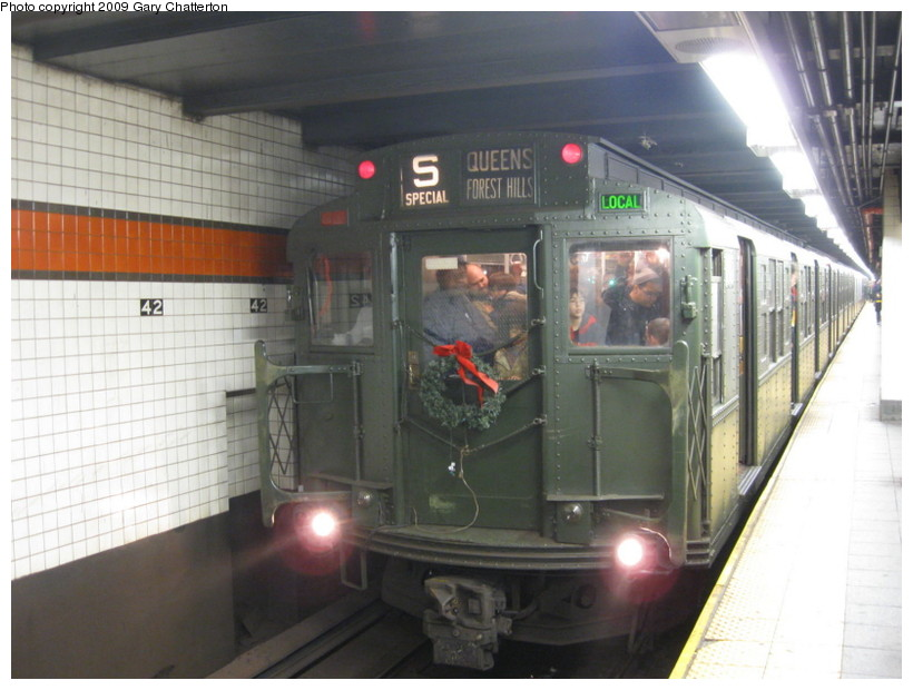 (121k, 820x620)<br><b>Country:</b> United States<br><b>City:</b> New York<br><b>System:</b> New York City Transit<br><b>Line:</b> IND 6th Avenue Line<br><b>Location:</b> 42nd Street/Bryant Park <br><b>Route:</b> Museum Train Service (V)<br><b>Car:</b> R-1 (American Car & Foundry, 1930-1931) 100 <br><b>Photo by:</b> Gary Chatterton<br><b>Date:</b> 12/14/2008<br><b>Viewed (this week/total):</b> 0 / 2115
