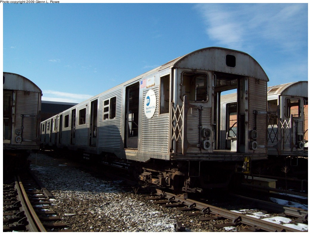 (229k, 1044x788)<br><b>Country:</b> United States<br><b>City:</b> New York<br><b>System:</b> New York City Transit<br><b>Location:</b> 207th Street Yard<br><b>Car:</b> R-32 (Budd, 1964)  3848 <br><b>Photo by:</b> Glenn L. Rowe<br><b>Date:</b> 1/26/2009<br><b>Notes:</b> Scrap<br><b>Viewed (this week/total):</b> 0 / 1096