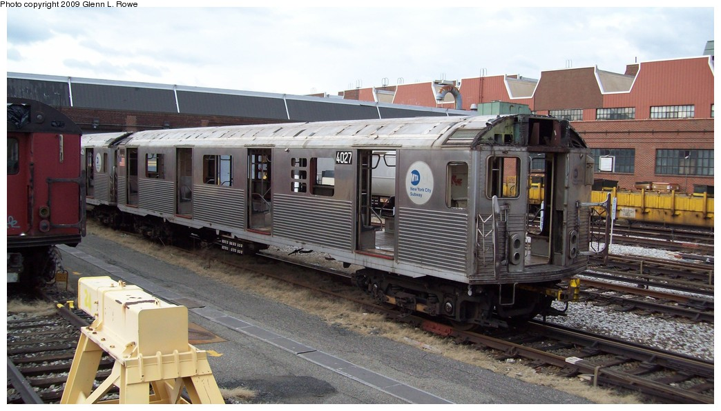 (192k, 1044x596)<br><b>Country:</b> United States<br><b>City:</b> New York<br><b>System:</b> New York City Transit<br><b>Location:</b> 207th Street Yard<br><b>Car:</b> R-38 (St. Louis, 1966-1967)  4027 <br><b>Photo by:</b> Glenn L. Rowe<br><b>Date:</b> 2/12/2009<br><b>Notes:</b> Scrap<br><b>Viewed (this week/total):</b> 3 / 1298