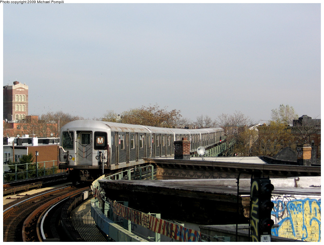 (253k, 1044x788)<br><b>Country:</b> United States<br><b>City:</b> New York<br><b>System:</b> New York City Transit<br><b>Line:</b> BMT Myrtle Avenue Line<br><b>Location:</b> Fresh Pond Road <br><b>Route:</b> M<br><b>Car:</b> R-42 (St. Louis, 1969-1970)  4750 <br><b>Photo by:</b> Michael Pompili<br><b>Date:</b> 12/2/2004<br><b>Viewed (this week/total):</b> 0 / 1527