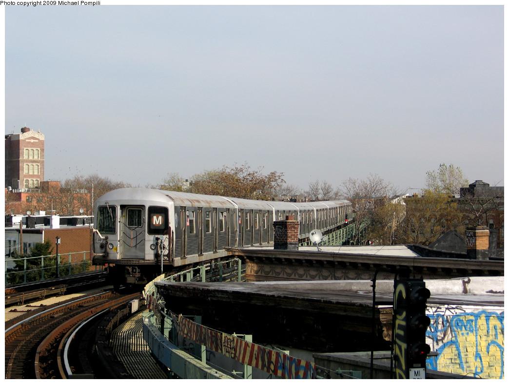 (253k, 1044x788)<br><b>Country:</b> United States<br><b>City:</b> New York<br><b>System:</b> New York City Transit<br><b>Line:</b> BMT Myrtle Avenue Line<br><b>Location:</b> Fresh Pond Road <br><b>Route:</b> M<br><b>Car:</b> R-42 (St. Louis, 1969-1970)  4750 <br><b>Photo by:</b> Michael Pompili<br><b>Date:</b> 12/2/2004<br><b>Viewed (this week/total):</b> 0 / 1533