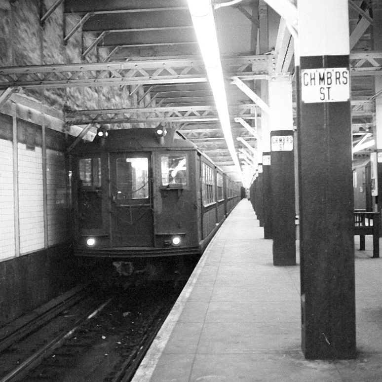 (256k, 1044x727)<br><b>Country:</b> United States<br><b>City:</b> New York<br><b>System:</b> New York City Transit<br><b>Line:</b> 3rd Avenue El<br><b>Location:</b> Chatham Square <br><b>Car:</b> MUDC  <br><b>Photo by:</b> Joel Shanus<br><b>Notes:</b> View from what is now Park Row, looking northeast towards East Broadway (Manhattan Bridge is visible in the background, under the el).  The buildings on the right have been demolished for high rise housing, but the building in the center is still in use today.<br><b>Viewed (this week/total):</b> 1 / 3735