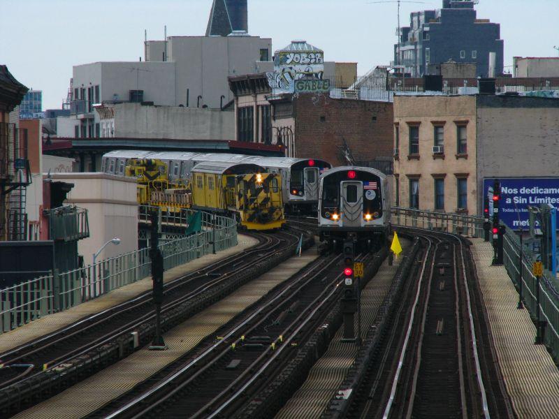(101k, 800x600)<br><b>Country:</b> United States<br><b>City:</b> New York<br><b>System:</b> New York City Transit<br><b>Line:</b> BMT Nassau Street/Jamaica Line<br><b>Location:</b> Lorimer Street <br><b>Route:</b> M<br><b>Car:</b> R-160A-1 (Alstom, 2005-2008, 4 car sets)   <br><b>Photo by:</b> Bill E.<br><b>Date:</b> 2/28/2009<br><b>Notes:</b> Two R160 M trains and locomovtive #884.<br><b>Viewed (this week/total):</b> 1 / 2065