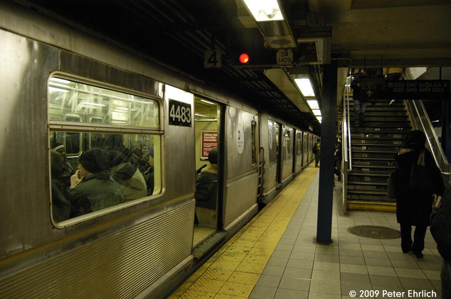 (210k, 930x618)<br><b>Country:</b> United States<br><b>City:</b> New York<br><b>System:</b> New York City Transit<br><b>Line:</b> IND Queens Boulevard Line<br><b>Location:</b> Roosevelt Avenue <br><b>Route:</b> E<br><b>Car:</b> R-40M (St. Louis, 1969)  4483 <br><b>Photo by:</b> Peter Ehrlich<br><b>Date:</b> 2/24/2009<br><b>Notes:</b> Outbound<br><b>Viewed (this week/total):</b> 0 / 1482
