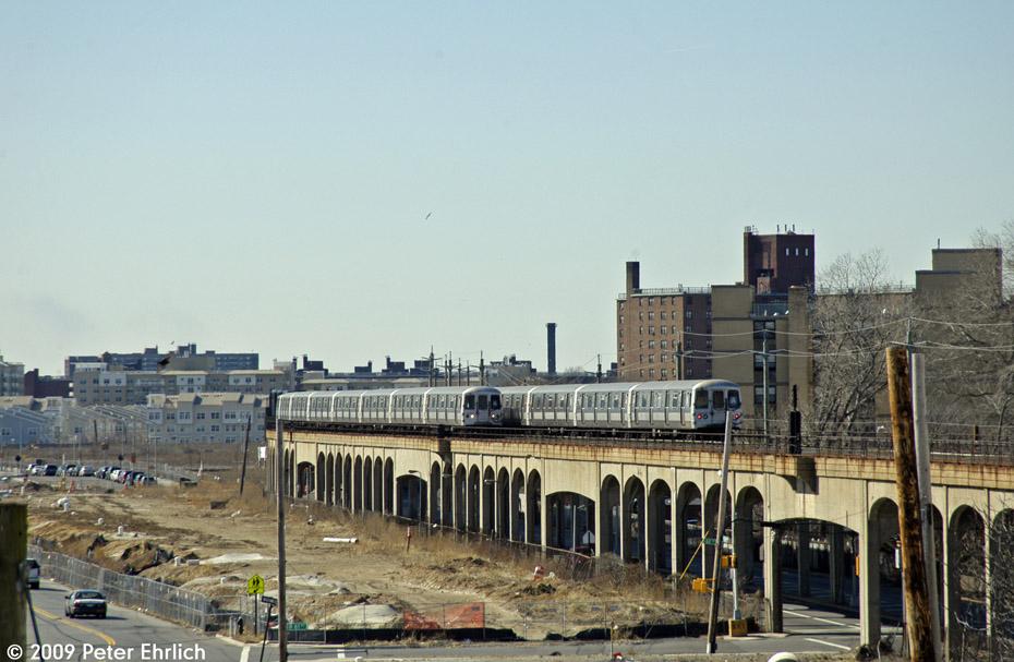 (190k, 930x607)<br><b>Country:</b> United States<br><b>City:</b> New York<br><b>System:</b> New York City Transit<br><b>Line:</b> IND Rockaway<br><b>Location:</b> Beach 60th Street/Straiton <br><b>Route:</b> A<br><b>Car:</b> R-44 (St. Louis, 1971-73) 5376 <br><b>Photo by:</b> Peter Ehrlich<br><b>Date:</b> 2/24/2009<br><b>Notes:</b> Trailing view.  With 5358 outbound.<br><b>Viewed (this week/total):</b> 1 / 1817