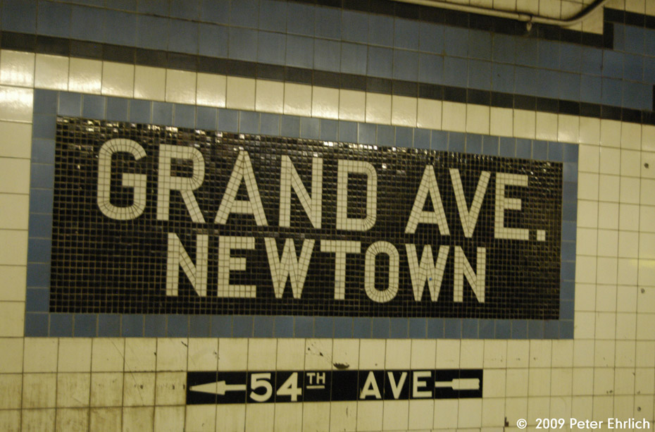 (197k, 930x613)<br><b>Country:</b> United States<br><b>City:</b> New York<br><b>System:</b> New York City Transit<br><b>Line:</b> IND Queens Boulevard Line<br><b>Location:</b> Grand Avenue/Newtown <br><b>Photo by:</b> Peter Ehrlich<br><b>Date:</b> 2/24/2009<br><b>Notes:</b> Station tilework.<br><b>Viewed (this week/total):</b> 1 / 1134