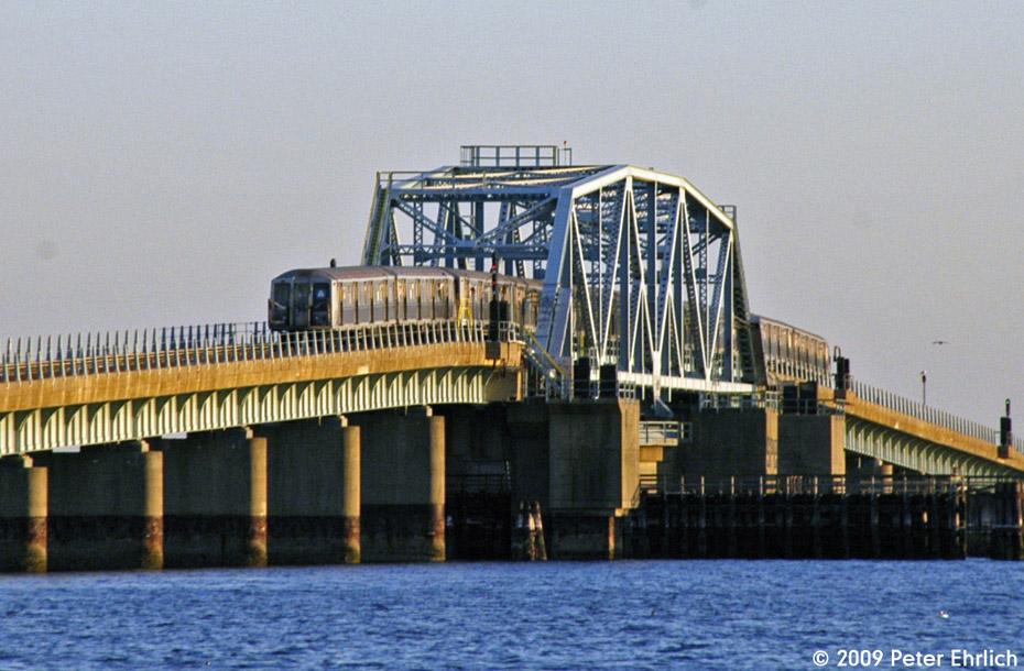 (210k, 930x610)<br><b>Country:</b> United States<br><b>City:</b> New York<br><b>System:</b> New York City Transit<br><b>Line:</b> IND Rockaway<br><b>Location:</b> North Channel Bridge <br><b>Route:</b> A<br><b>Car:</b> R-40 (St. Louis, 1968)  4265 <br><b>Photo by:</b> Peter Ehrlich<br><b>Date:</b> 3/4/2009<br><b>Notes:</b> Outbound.<br><b>Viewed (this week/total):</b> 0 / 1579