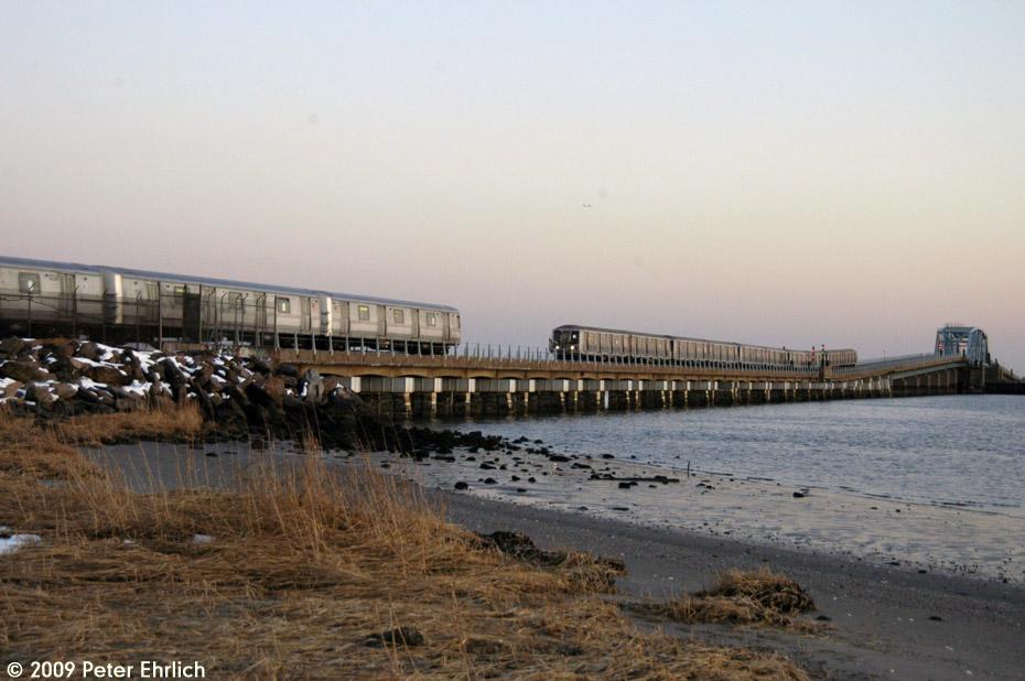 (178k, 930x618)<br><b>Country:</b> United States<br><b>City:</b> New York<br><b>System:</b> New York City Transit<br><b>Line:</b> IND Rockaway<br><b>Location:</b> North Channel Bridge <br><b>Route:</b> A<br><b>Car:</b> R-44 (St. Louis, 1971-73) 5240 <br><b>Photo by:</b> Peter Ehrlich<br><b>Date:</b> 3/4/2009<br><b>Notes:</b> Outbound. With R40 4399 inbound.<br><b>Viewed (this week/total):</b> 0 / 1410