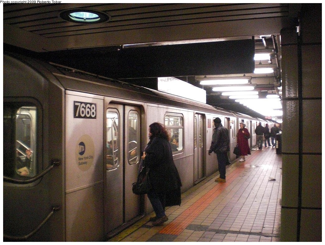 (318k, 1044x788)<br><b>Country:</b> United States<br><b>City:</b> New York<br><b>System:</b> New York City Transit<br><b>Line:</b> IRT East Side Line<br><b>Location:</b> 103rd Street <br><b>Route:</b> 6<br><b>Car:</b> R-142A (Option Order, Kawasaki, 2002-2003)  7668 <br><b>Photo by:</b> Roberto C. Tobar<br><b>Date:</b> 3/6/2009<br><b>Viewed (this week/total):</b> 4 / 1852
