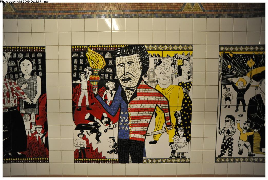 (308k, 1044x701)<br><b>Country:</b> United States<br><b>City:</b> New York<br><b>System:</b> New York City Transit<br><b>Line:</b> IRT West Side Line<br><b>Location:</b> Christopher Street/Sheridan Square <br><b>Photo by:</b> David Pirmann<br><b>Date:</b> 3/15/2009<br><b>Artwork:</b> <i>The Greenwich Village Murals</i>, Lee Brozgol (1994).<br><b>Viewed (this week/total):</b> 0 / 1613