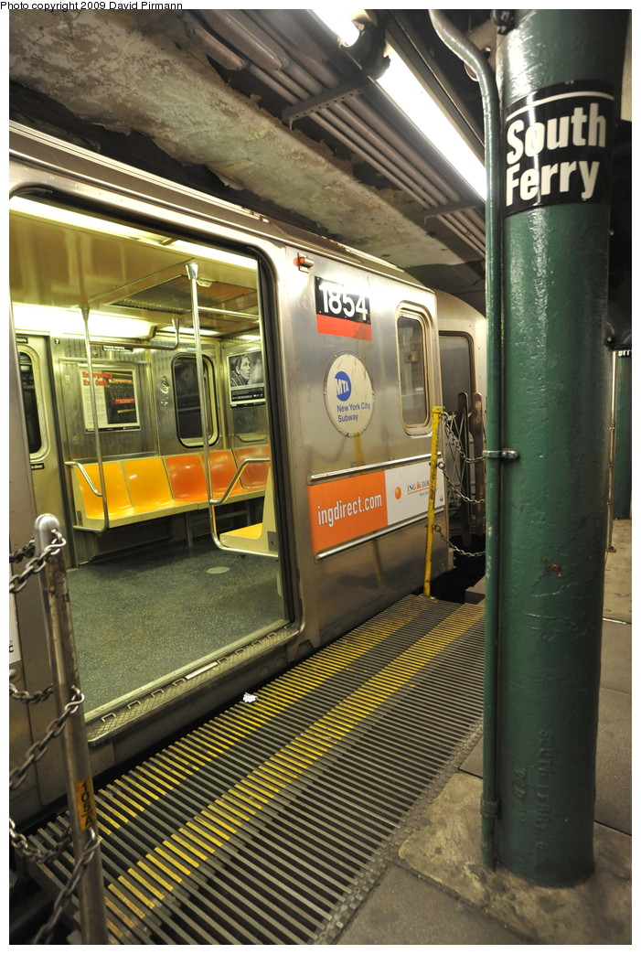 (301k, 701x1043)<br><b>Country:</b> United States<br><b>City:</b> New York<br><b>System:</b> New York City Transit<br><b>Line:</b> IRT West Side Line<br><b>Location:</b> South Ferry (Outer Loop Station) <br><b>Route:</b> 1<br><b>Car:</b> R-62A (Bombardier, 1984-1987)  1854 <br><b>Photo by:</b> David Pirmann<br><b>Date:</b> 3/15/2009<br><b>Notes:</b> Final day of revenue service at loop station.<br><b>Viewed (this week/total):</b> 0 / 1178