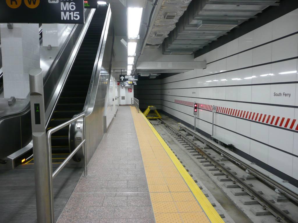 (121k, 1024x768)<br><b>Country:</b> United States<br><b>City:</b> New York<br><b>System:</b> New York City Transit<br><b>Line:</b> IRT West Side Line<br><b>Location:</b> South Ferry (New Station) <br><b>Photo by:</b> Robbie Rosenfeld<br><b>Date:</b> 3/16/2009<br><b>Notes:</b> Escalator to mezzanine; bumper block.<br><b>Viewed (this week/total):</b> 1 / 1789
