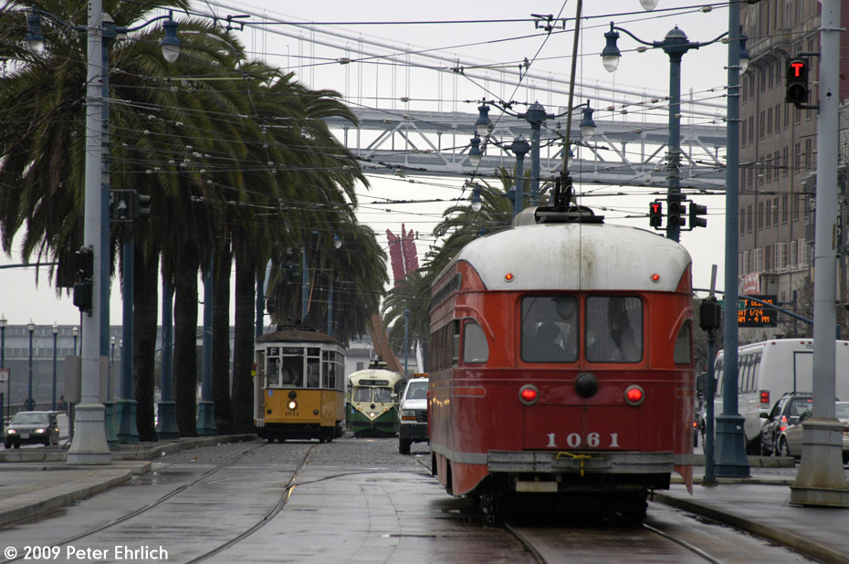 (226k, 930x618)<br><b>Country:</b> United States<br><b>City:</b> San Francisco/Bay Area, CA<br><b>System:</b> SF MUNI<br><b>Location:</b> Embarcadero/Ferry Plaza Layover <br><b>Car:</b> SF MUNI PCC (Ex-SEPTA) (St. Louis Car Co., 1947-1948)  1061 <br><b>Photo by:</b> Peter Ehrlich<br><b>Date:</b> 1/23/2009<br><b>Notes:</b> Outbound. Trailing view.  With 1811 (Milan yellow/white) and 1062 (Louisville) laying over.<br><b>Viewed (this week/total):</b> 0 / 352