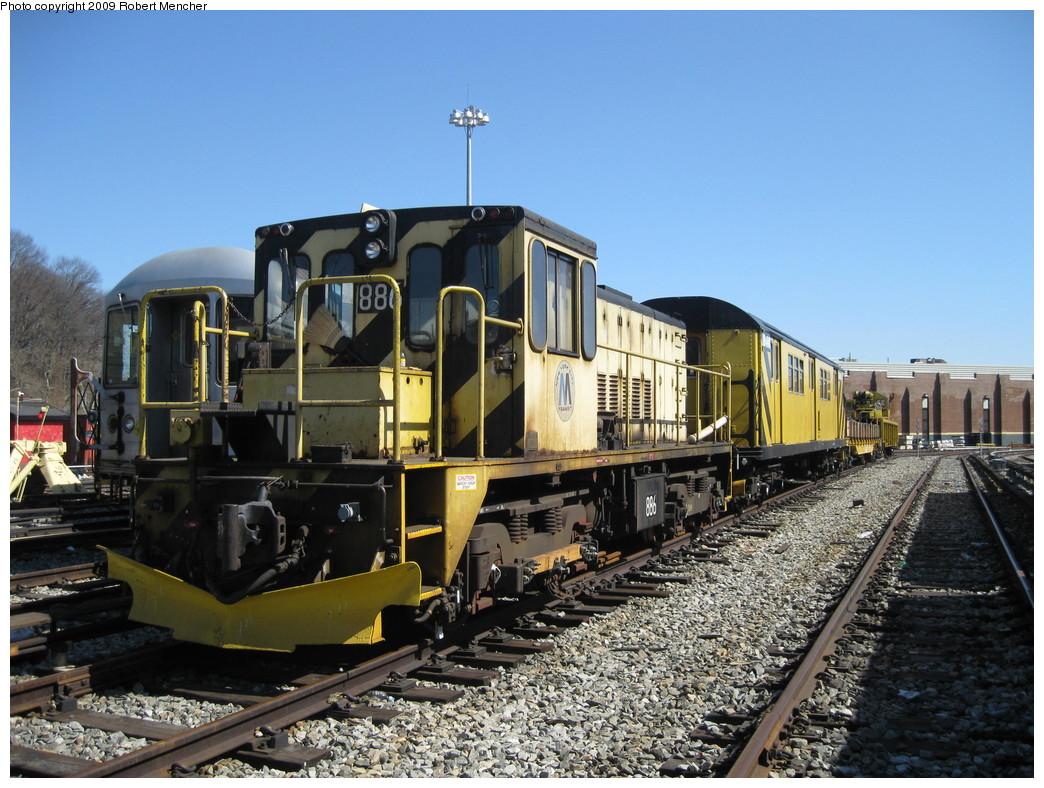 (256k, 1044x788)<br><b>Country:</b> United States<br><b>City:</b> New York<br><b>System:</b> New York City Transit<br><b>Location:</b> East New York Yard/Shops<br><b>Car:</b> R-77 Locomotive  886 <br><b>Photo by:</b> Robert Mencher<br><b>Date:</b> 3/23/2009<br><b>Viewed (this week/total):</b> 1 / 589
