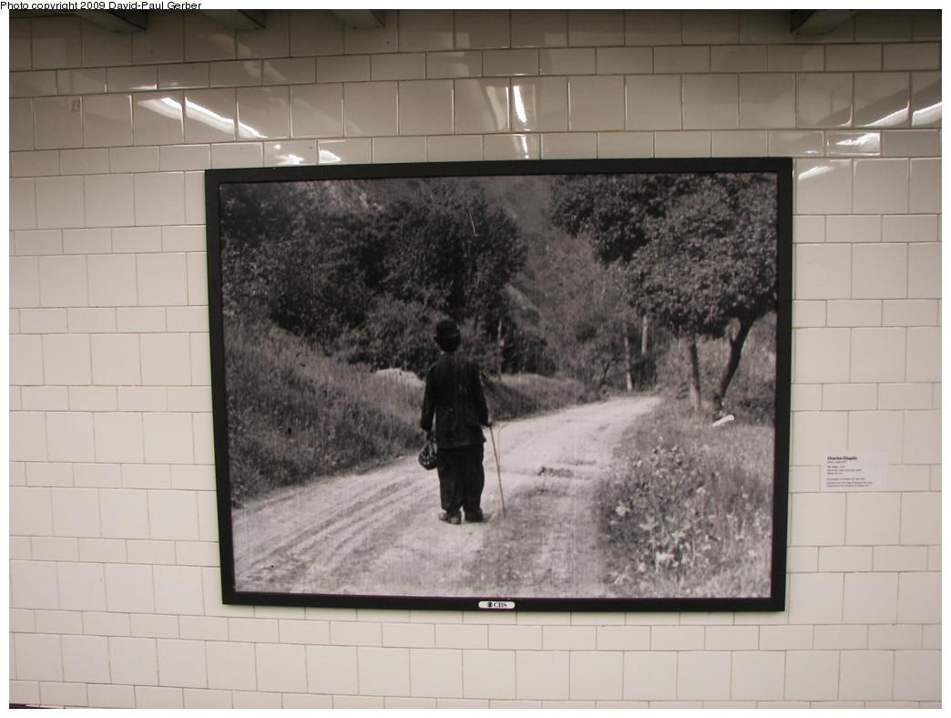 (225k, 1044x788)<br><b>Country:</b> United States<br><b>City:</b> New York<br><b>System:</b> New York City Transit<br><b>Line:</b> BMT 4th Avenue<br><b>Location:</b> Pacific Street <br><b>Photo by:</b> David-Paul Gerber<br><b>Date:</b> 3/11/2009<br><b>Artwork:</b> <i>MoMA Atlantic/Pacific</i>, artist unknown (2009).<br><b>Notes:</b> Charles Chaplin, <i>The Tramp</i> (film still from 1915)<br><b>Viewed (this week/total):</b> 0 / 1003