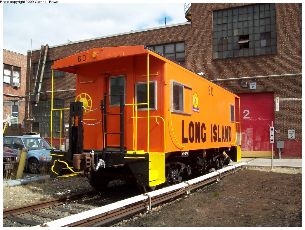 (277k, 1044x788)<br><b>Country:</b> United States<br><b>City:</b> New York<br><b>System:</b> New York City Transit<br><b>Location:</b> 207th Street Yard<br><b>Car:</b> LIRR Caboose 60 <br><b>Photo by:</b> Glenn L. Rowe<br><b>Date:</b> 4/7/2009<br><b>Notes:</b> LIRR Caboose 60 at 207th St. Shop for some work before being displayed at the New York Transit Museum.<br><b>Viewed (this week/total):</b> 0 / 1047