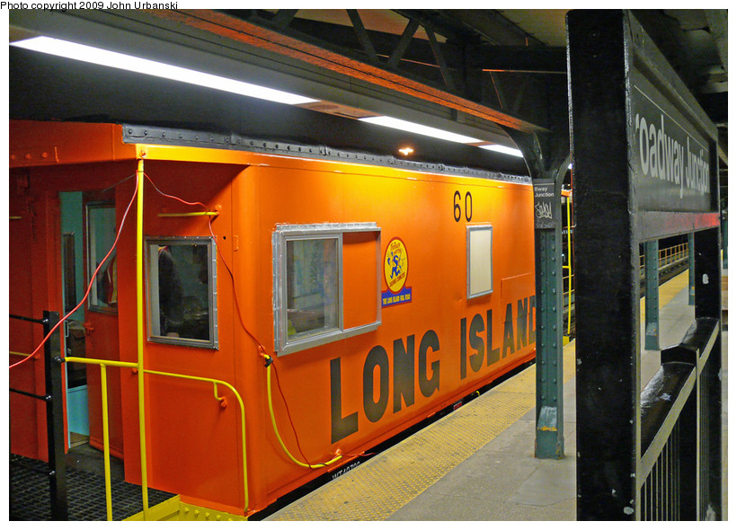 (213k, 820x590)<br><b>Country:</b> United States<br><b>City:</b> New York<br><b>System:</b> New York City Transit<br><b>Line:</b> BMT Nassau Street/Jamaica Line<br><b>Location:</b> Broadway/East New York (Broadway Junction) <br><b>Car:</b> LIRR Caboose 60 <br><b>Photo by:</b> John Urbanski<br><b>Date:</b> 4/4/2009<br><b>Notes:</b> LIRR Caboose 60 enroute to 207th St. Shop for some work before being displayed at the New York Transit Museum.<br><b>Viewed (this week/total):</b> 0 / 1378