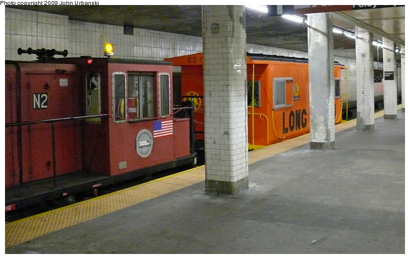 (148k, 820x517)<br><b>Country:</b> United States<br><b>City:</b> New York<br><b>System:</b> New York City Transit<br><b>Line:</b> BMT Nassau Street/Jamaica Line<br><b>Location:</b> Chambers Street <br><b>Car:</b> LIRR Caboose 60 <br><b>Photo by:</b> John Urbanski<br><b>Date:</b> 4/4/2009<br><b>Notes:</b> LIRR Caboose 60 enroute to 207th St. Shop for some work before being displayed at the New York Transit Museum.<br><b>Viewed (this week/total):</b> 0 / 3841