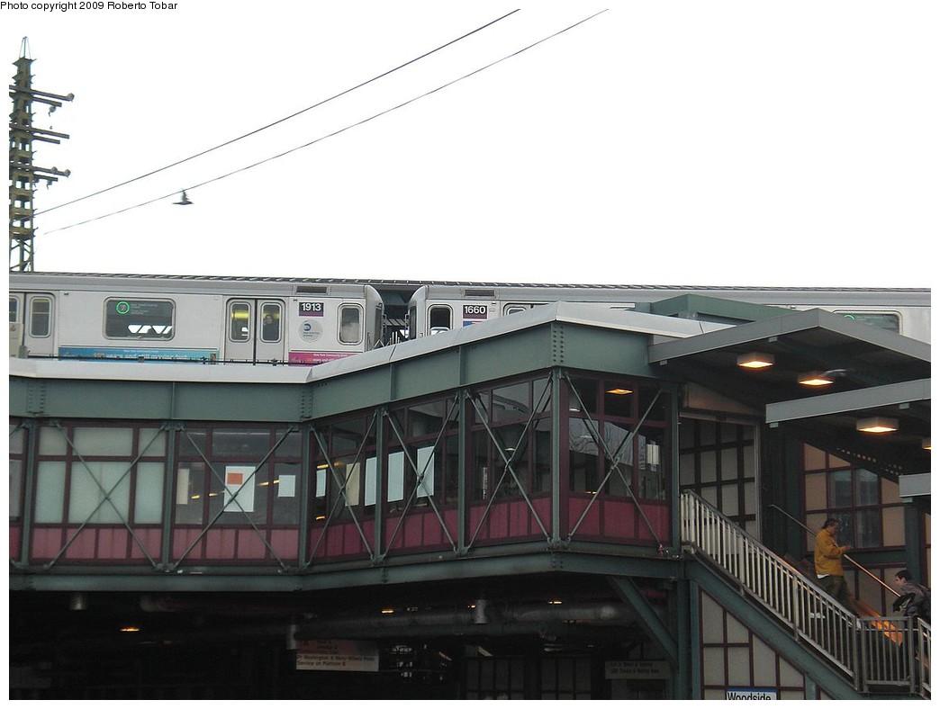 (179k, 1044x788)<br><b>Country:</b> United States<br><b>City:</b> New York<br><b>System:</b> New York City Transit<br><b>Line:</b> IRT Flushing Line<br><b>Location:</b> 61st Street/Woodside <br><b>Route:</b> 7<br><b>Car:</b> R-62A (Bombardier, 1984-1987)  1913/1660 <br><b>Photo by:</b> Roberto C. Tobar<br><b>Date:</b> 4/8/2009<br><b>Viewed (this week/total):</b> 2 / 1636