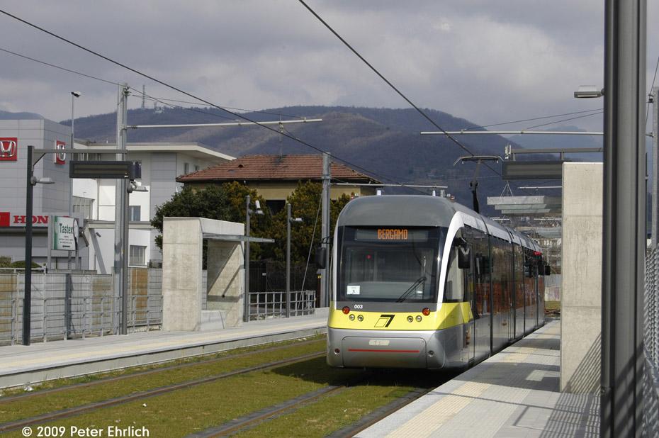 (192k, 930x618)<br><b>Country:</b> Italy<br><b>City:</b> Bergamo<br><b>System:</b> Tramvie Elettriche Bergamasche <br><b>Location:</b> San Fermo <br><b>Car:</b> Sirio Bergamo (AnsaldoBreda, 2008) 003 <br><b>Photo by:</b> Peter Ehrlich<br><b>Date:</b> 3/20/2009<br><b>Notes:</b> Outbound.<br><b>Viewed (this week/total):</b> 0 / 491