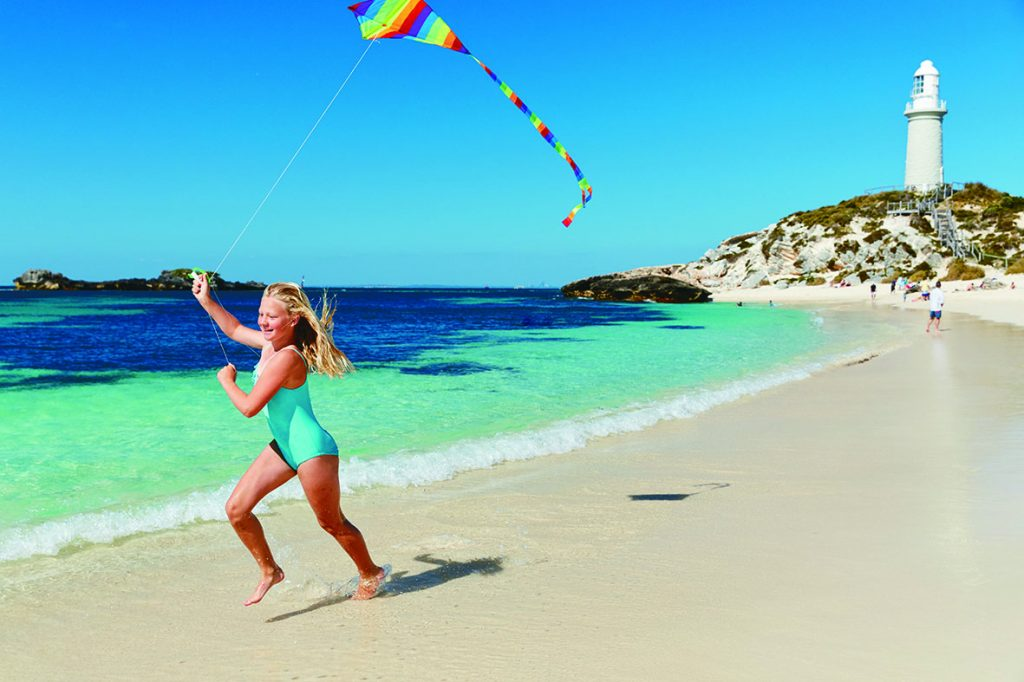 Girl running on beach on rottnest island