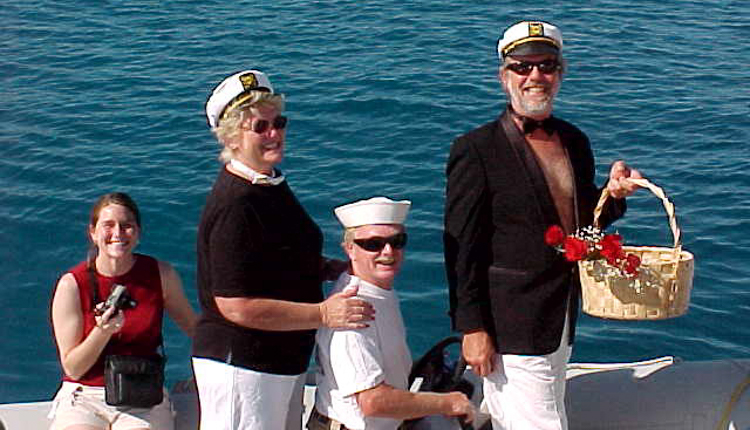 Ocean Getaways charter brokers delivering roses to group