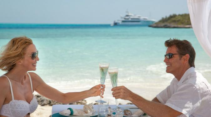 couple toasting off theie yacht in the BVI