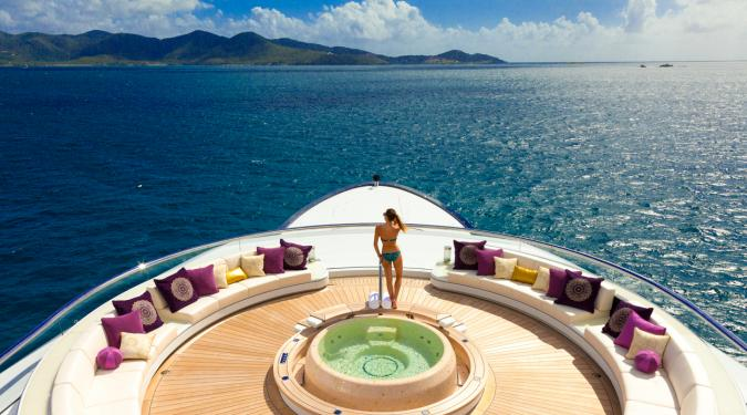 woman on bow of superyacht