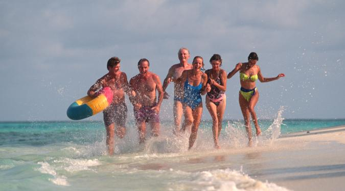couples running on BVI beach