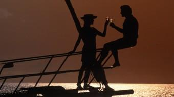 couples toasting sunset on BVI sailing vacation