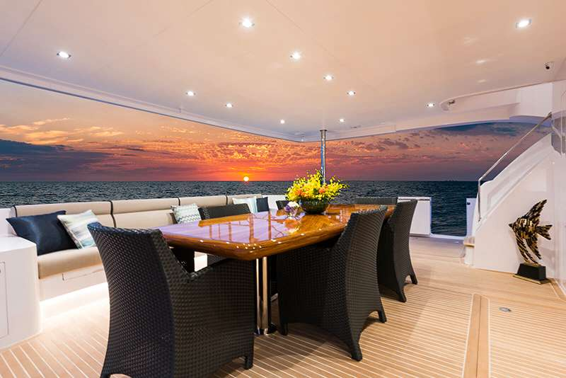 ondeck dining on Sea Glass power catamaran charter
