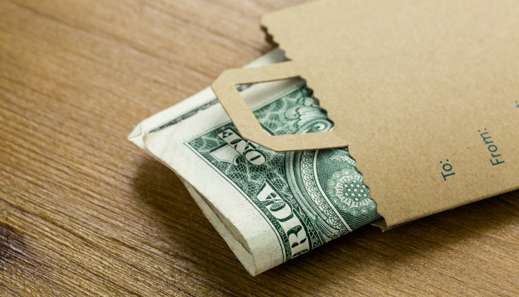 yacht charter price -Dollar bills in paper bag