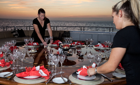 stewardess setting table on a superyacht