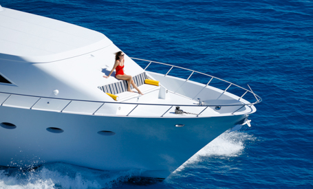woman on bow on motor yacht charter of motor yacht