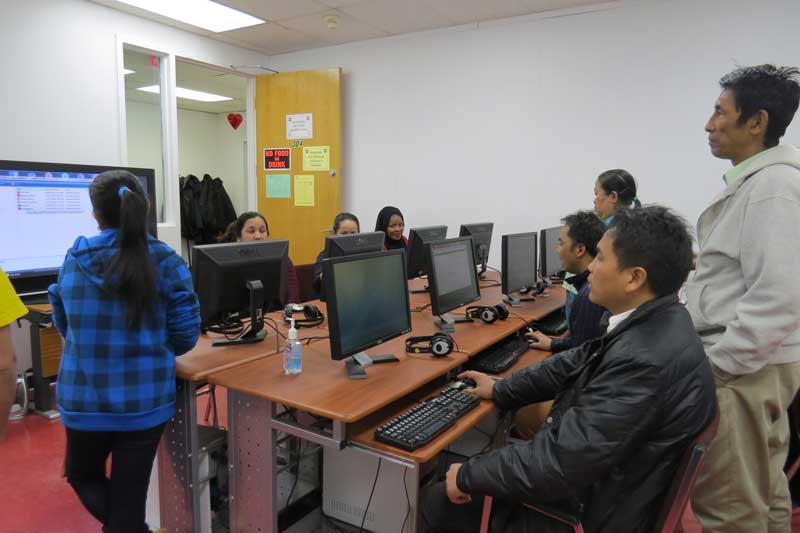 LINC students learning English in computer lab