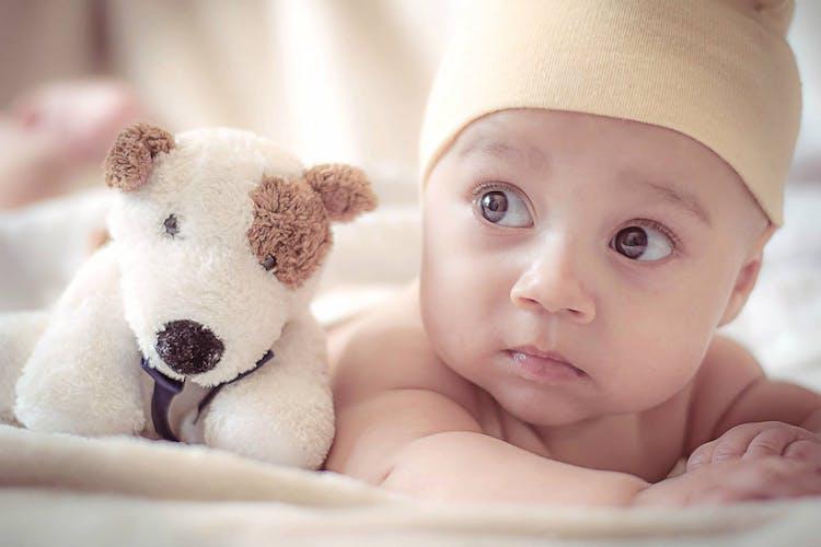 baby and stuffed dog