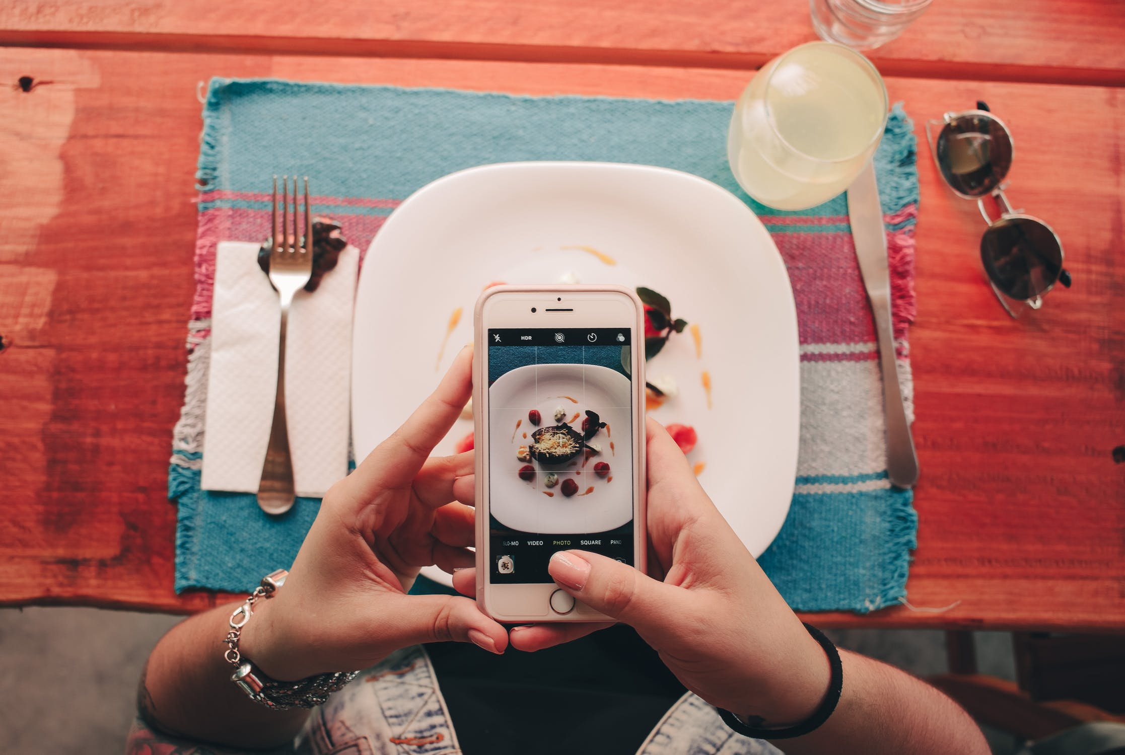 foodie instagramming meal