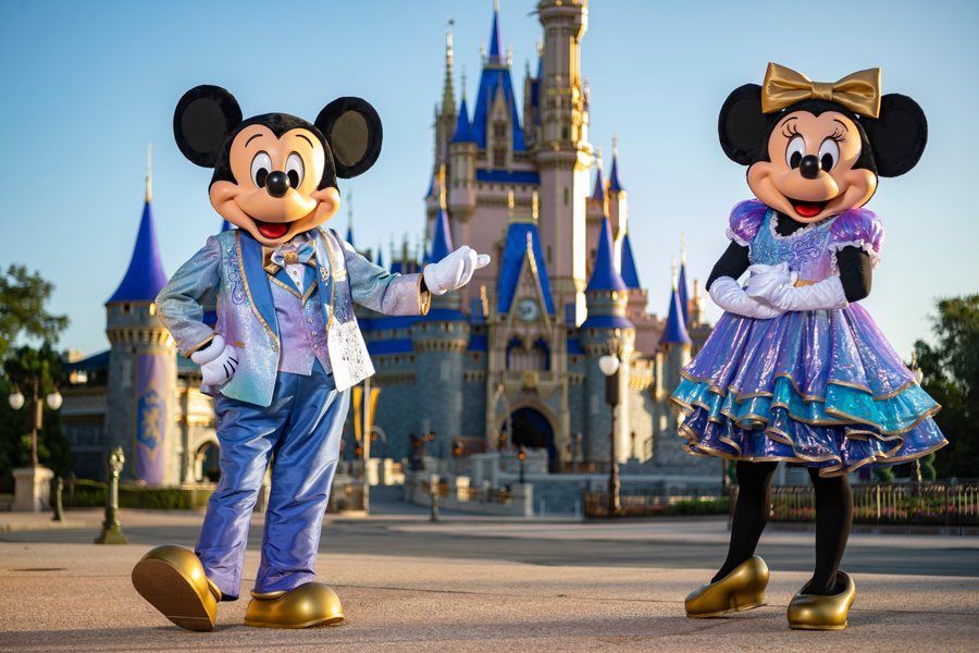 Mickey and Minnie wearing purple, gold, and teal