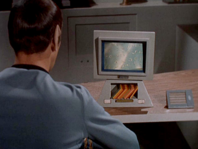 Spock looks at data on the Enterprise computer