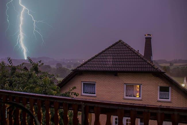lightning striking a home