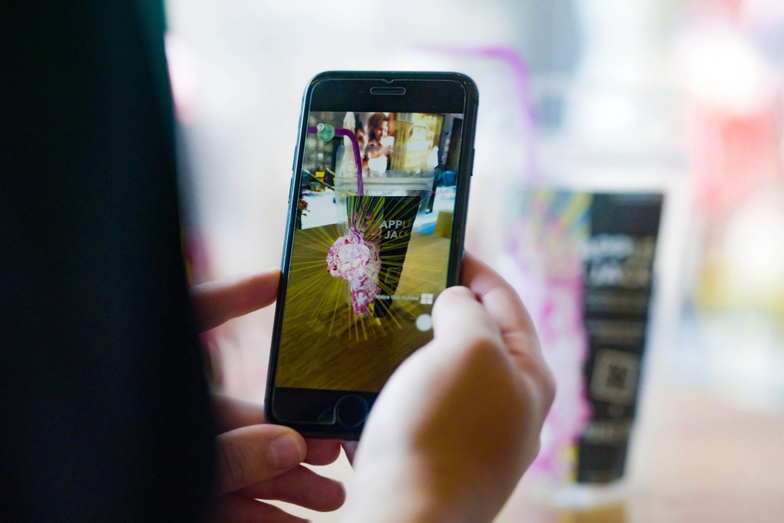 Person using augmented reality app with flowers