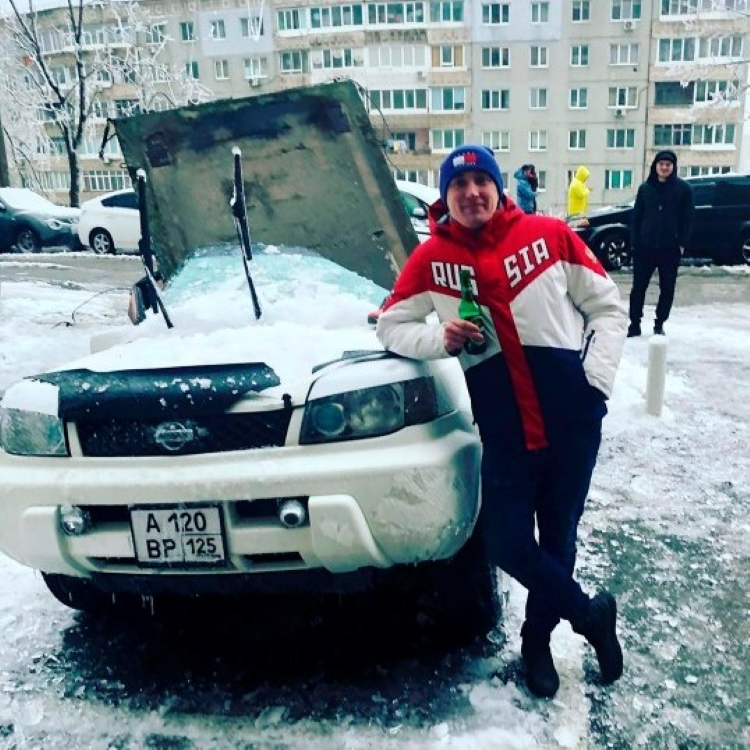 Alexander of Vladivostck Russia next to his car