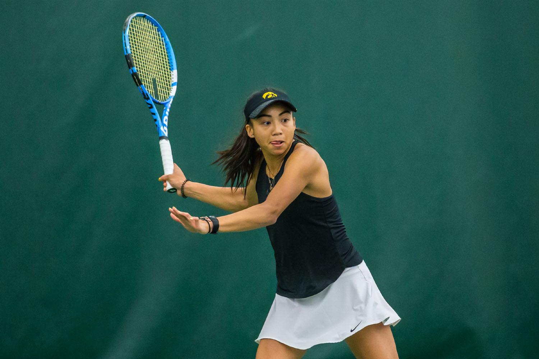 woman hitting tennis forehand