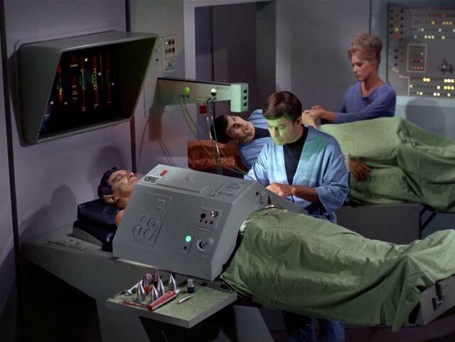 Dr. McCoy examines the Vulcan Sarek