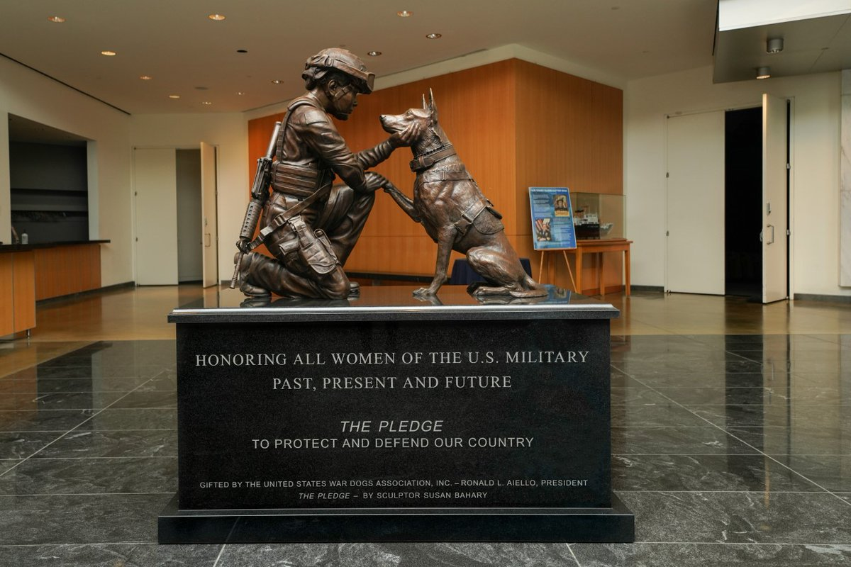 military women and dog
