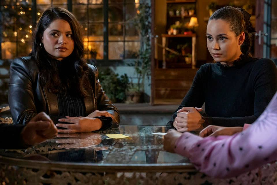 Charmed Ones and Harry gathered around table