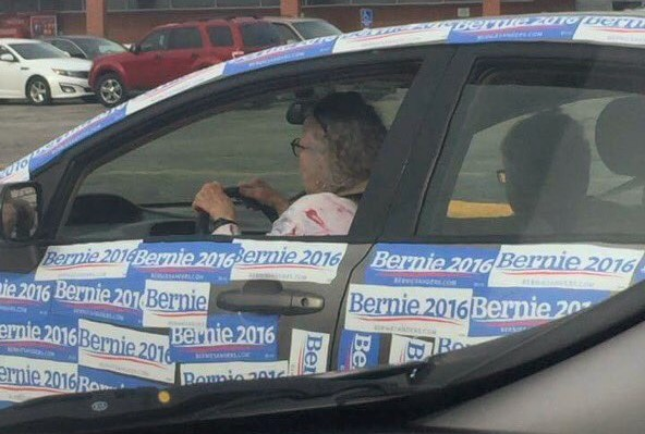 car with bernie sanders bumper stickers